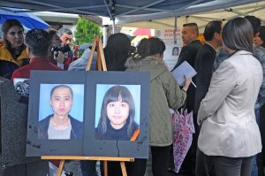 In trial · Photos of Ming Qu and Ying Qu, the victims of a 2012 murder, are shown at a press conference. Javier Bolden is on trial for the killings. - Daily Trojan File Photo