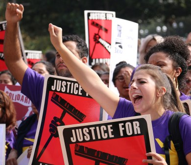 Rally on  · Janitors, faculty and students demonstrate in Hahn Plaza Tuesday to urge USC to support janitors during their contract negotiations.  - Beverly Pham | Daily Trojan