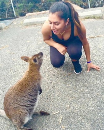 Wallaby damned · Columnist Nika Shahery approaches a wallaby. Journeying throughout Tasmania allows for many chances to engage with wildlife, especially marsupials like wallabies and kangaroos.  - Nika Shahery | Daily Trojan