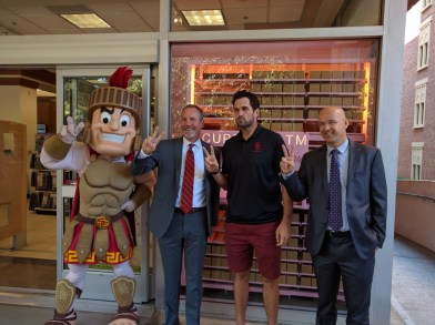 Allen Pham | Daily Trojan Sweet stuff · Former USC starting quarterback Matt Leinart (center-right) poses with USC Hospitality staff at the opening of the Sprinkles ATM at the Pertusati Bookstore Monday. The machine is the result of months of work by USC Hospitality to find a local vendor.
