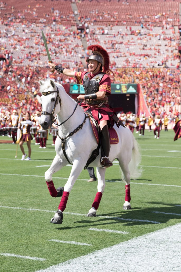 Nick Entin | Daily Trojan Traveler, ridden by Hector Aguilar, gallops around the field prior to kickoff.