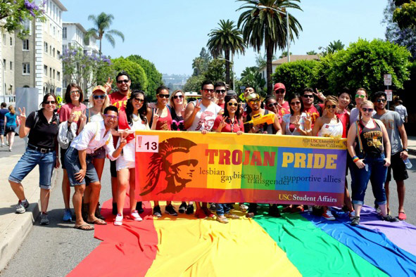 Photo courtesy of the USC LGBT Resource Center  Trojan pride · USC students show their support for LGBT rights at the 2014 Los Angeles Pride Parade. Groups like the LGBT Resource Center, which organized the march, also help make athletics more inclusive.