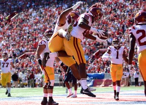 USC tight end Daniel Imatorbhebhe celebrates with a teammate after scoring a touchdown against Arizona on Saturday, Oct. 15 in Tucson, Ariz. - Sydney Richardson / The Daily Wildcat