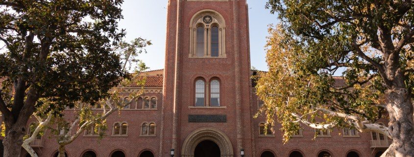 An image of the building Bovard on campus, showing its red brick entrance