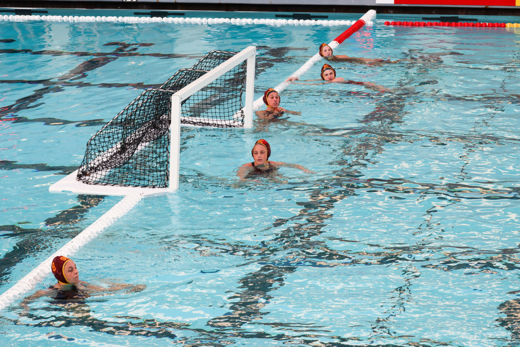 The Trojans lined up during a stoppage in play in a water polo game.