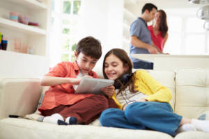 kids looking at ipad