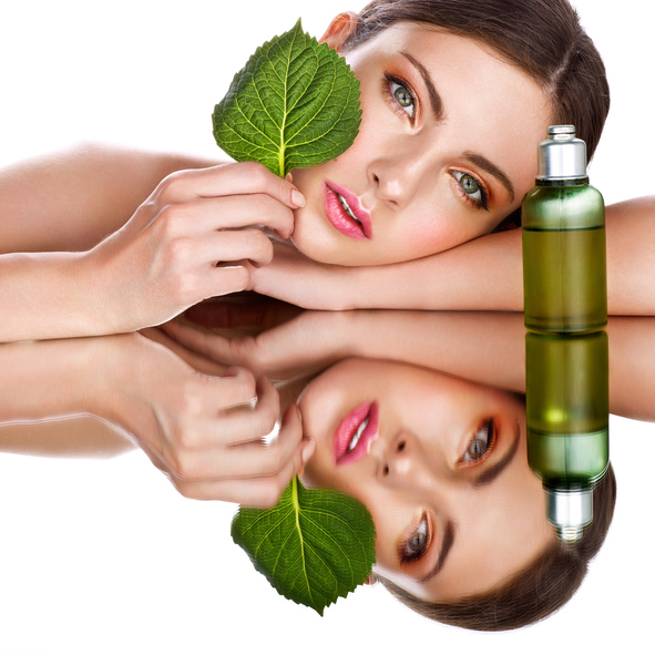 woman using organic skin care products