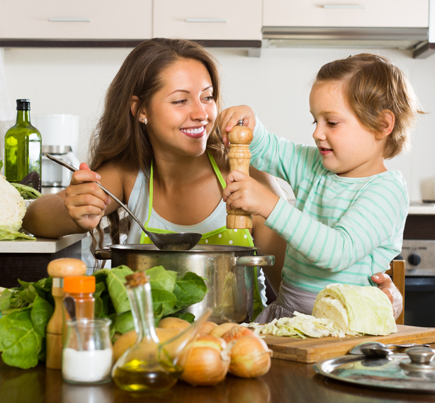 mom cooking with kid