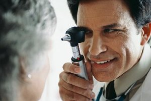 A doctor examines a woman's eyes