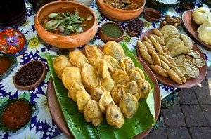 Chiles rellenos on a table of food.