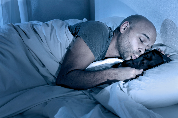 man sleeping with tablet