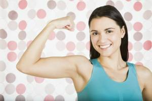 Woman flexing her bicep, woman with toned arms