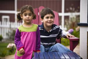 Brother and sister in backyard, boy and girl
