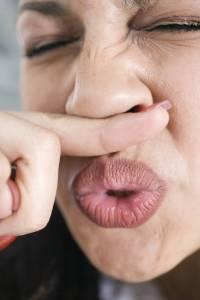 hispanic woman sneezing