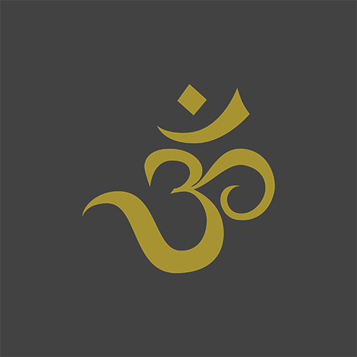 gold om symbol on dark gray background