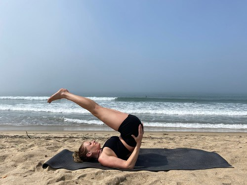 Ardha Sarvangasana - half shoulder stand pose - yoga pose girl sunny day yoga on the beach