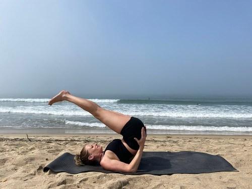 Ardha Sarvangasana - half shoulder stand pose - yoga pose girl sunny day yoga on the beach