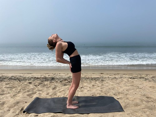 Salamba Anuvittasana - standing supported backbend pose - yoga pose girl sunny day yoga on the beach