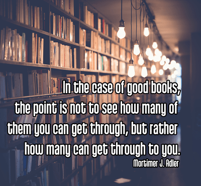 cool shot of library bookshelves full of books under light of bright edison bulbs - mindful mindfulness reading books Quote: In the case of good books, the point is not to see how many of them you can get through, but rather how many can get through to you. - Mortimer J. Adler original work - https://unsplash.com/photos/sfL_QOnmy00