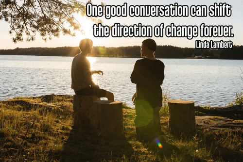 darkened couple sitting on grassy bank by a calm lake under bright setting sun - mindful conversation quality conversation Quote: One good conversation can shift the direction of change forever. - Linda Lambert  original work - https://unsplash.com/photos/aocUkMcxeqI