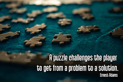 darkened brown puzzle pieces on dark green background - mindful mindfulness puzzle Quote: A puzzle challenges the player to get from a problem to a solution. - Ernest Adams  original work - https://unsplash.com/photos/IrbuQKtH9o4