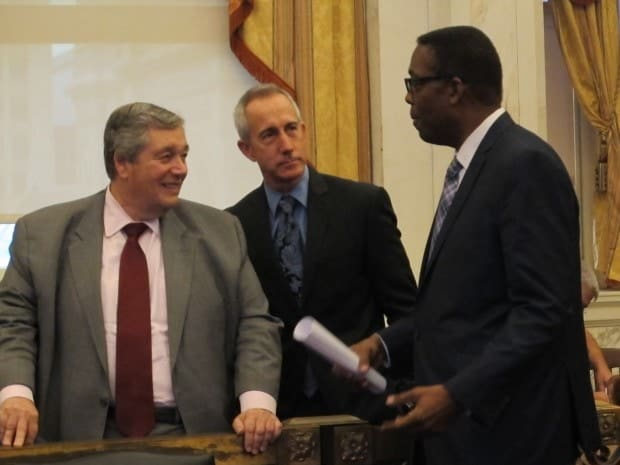 Philadelphia Energy Solutions CEO Phil Rinaldi (L), Philadelphia Gas Works CEO Craig White (C) and Philadelphia City Council President Darrell Clarke (R) share a moment before hearings on the future of Philadelphia as an energy hub earlier this year. Photo by Katie Colaner/State Impact Pennsylvania.