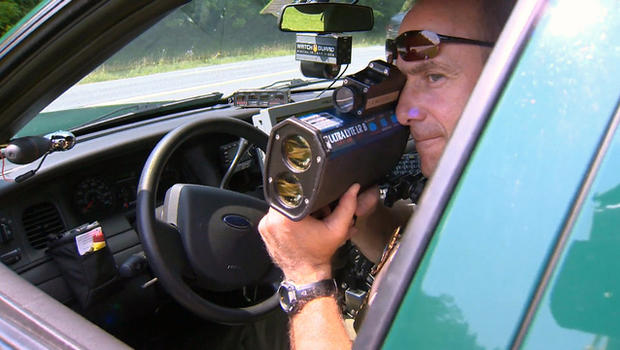 A police office in Hopewell, Virginia, watches for speeders. Hopewell made $1.8 million last year from its speed trap economy.