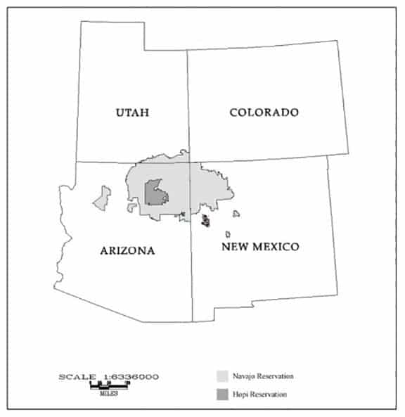The Navajo Nation, in light gray, sprawls over three states and encircles most of the Hopi reservation, in darker gray.