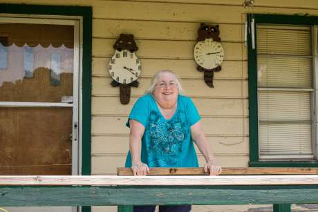 Susan Holmes on the front porch of her home in Bokoshe, Oklahoma. Photo by Joe Wertz/StateImpact Oklahoma