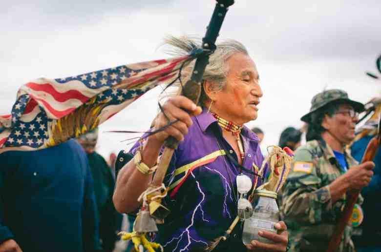 Phil Little Thunder Sr., from the Rosebud reservation in South Dakota, carries water from his hometown for the sacred ceremony to the burial ground in North Dakota.
