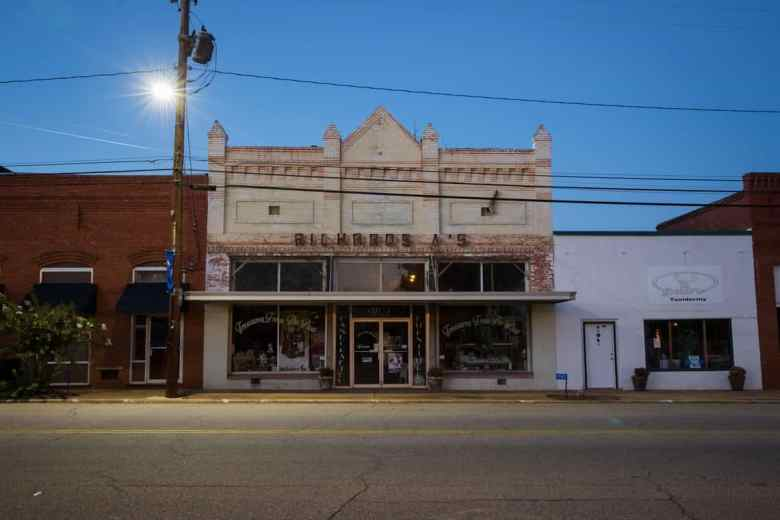 Downtown Lumpkin has a row of storefronts including a taxidermy shop, a sun-bleached gas station, and a gun store. Photo by Kevin Liles