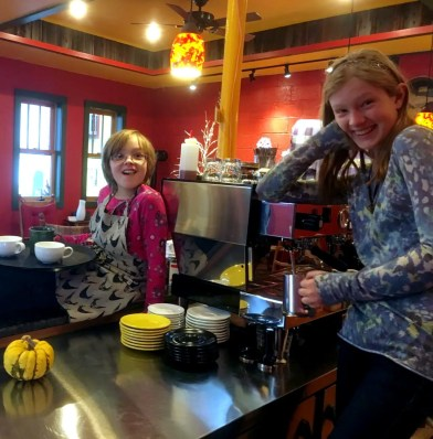 Hayes' daughters, Saoirse and Ula, pose inside the cafe.