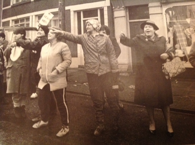 Welsh women line-up and point during a protest demonstration.