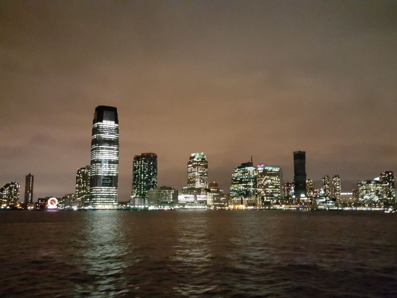 Jersey city night view from Hudson river cruise