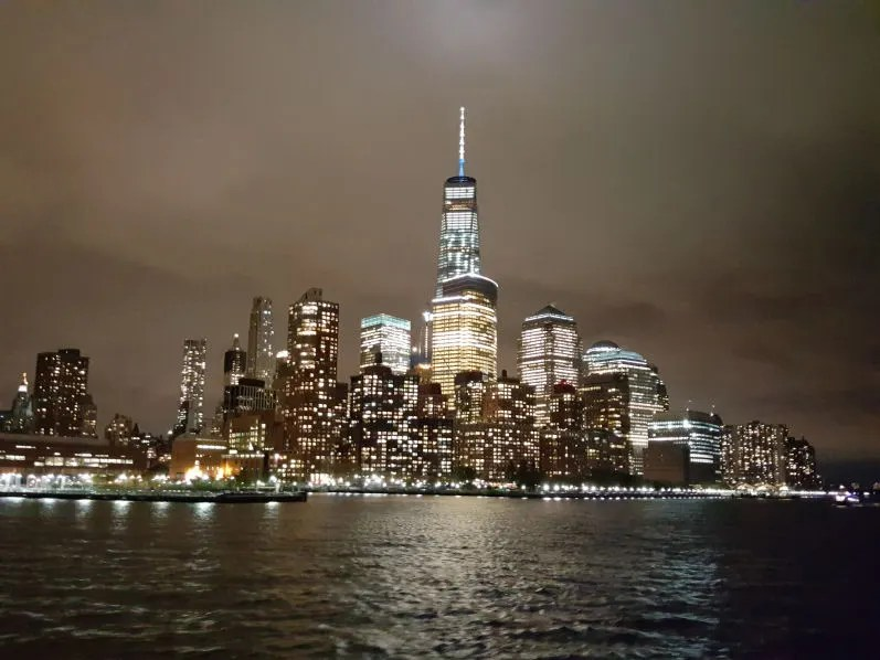 manhattan downtown view at night from the moonlight cruise