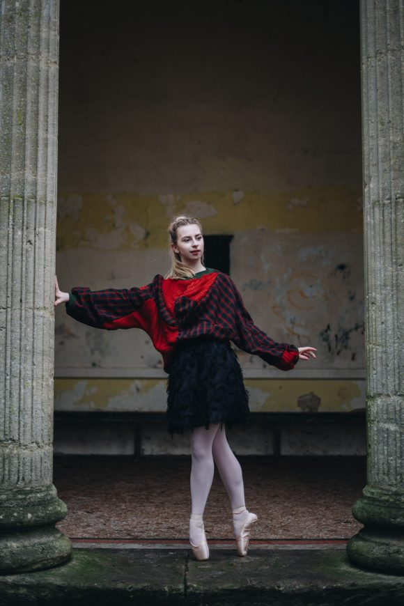 Front upcycled batwing jumper with acrylic jumper with textured black tutu skirt at the holbourne museum