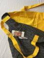 Inside detail shots of tartan and yellow tote bag showing top stitching