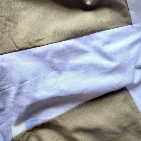 Details of panels. Zero waste design. Mixture of cotton panels on the bottom of the dress