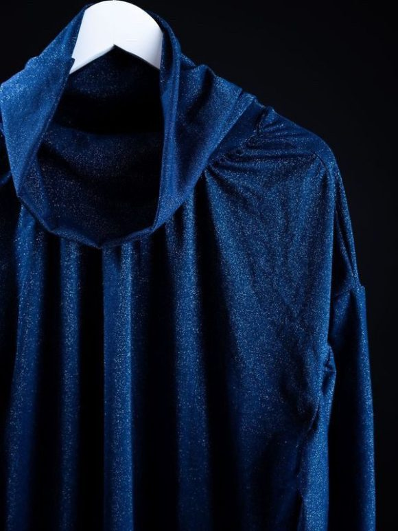 Blue glittery turtleneck in size large oversized and made by remnant dead stock materials.