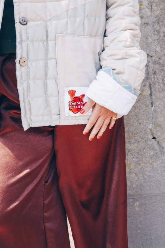 Close up deals of the beige quilted jacket and brown mimosa trousers photograph by Maisie Lee Walker in Bath, Somerset