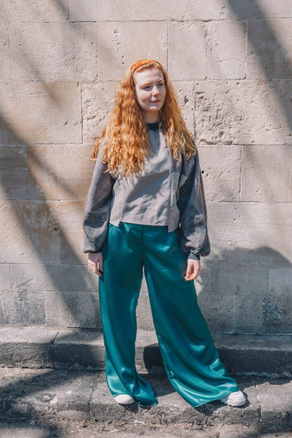 The green Mimosa Trousers made from dead stock Satin. Grace Daines wears The Mouse King Batwing that was featured on Depop. Photography by Maisie Lee Walker in Bath