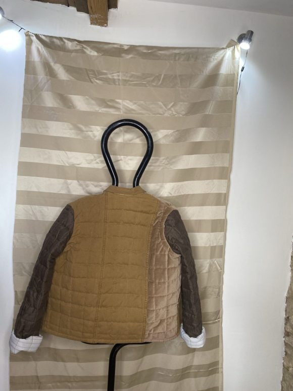 Back of Brown Quilted Jacket made from upcycled materials, boxy and oversized silhouette
