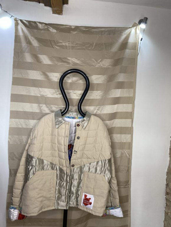 Front Photograph of the beige quilts jacket made from upcycled vintage remnant materials at The Silk Mill Studios in Frome