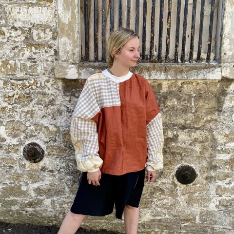 Multi material batwing jumper made from upcycled vintage remnants.
