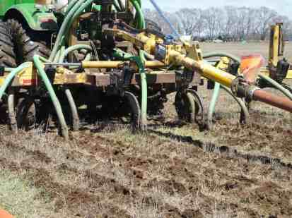 Manure being put on a field.