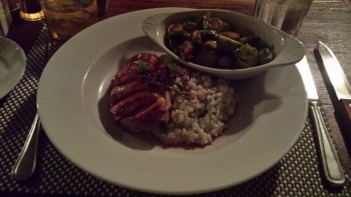 Poogan's Porch entree - Crispy Duck Breast with Risotto and Brussel Sprouts