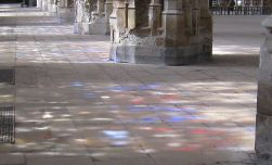 Light From Stained Glass Windows Splayed Across the Floor