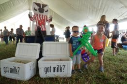 Jacob & Stella are some of our smallest volunteers offering smiles throughout the day! Those coolers are full of free frozen Gogurts for our guests.