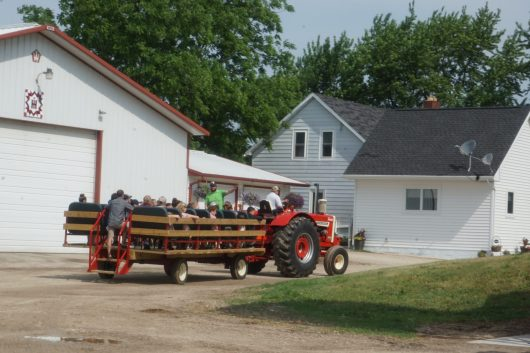As the tour begins, the guests learn about the history of the farmhouse and barn.