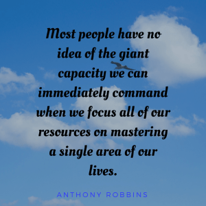Most people have no idea of the giant capacity we can immedialtely command when we focus all of our resources on mastering a single area of our lives.. Anthony Robbins. Words are printed on a sky with four clouds in the background.